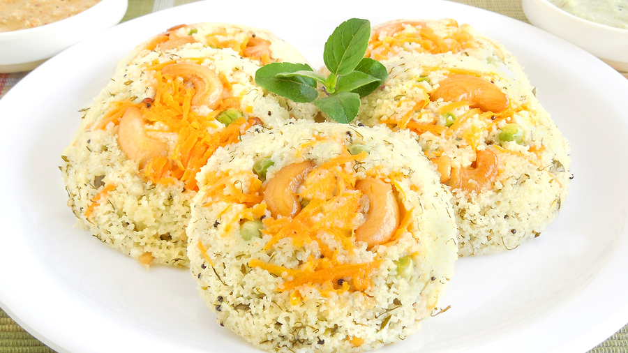 Rava idli or semolina cakes, an Indian steam-cooked vegetarian dish, which are typically eaten as breakfast.
